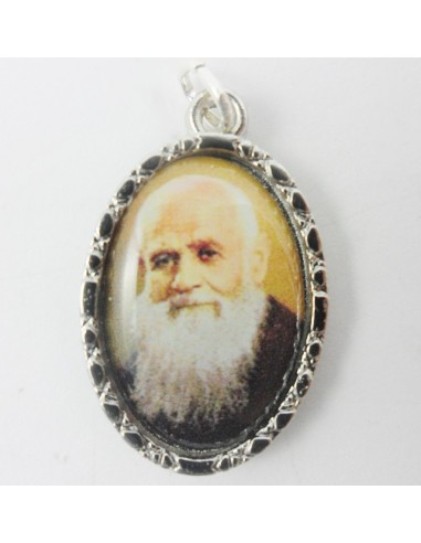 Medalla Fray Leopoldo con el Espiritu Santo en la parte de atras.  Terminada con diferentes motivos.  2,5 cm