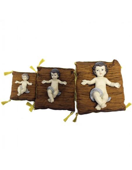 Niño Jesús con cojín resina disponible en diferentes medidas.