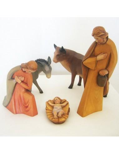 Nacimiento en madera tallada. Tipo moderno. Conjunto de 5 piezas. Dimensiones: 28 cm.