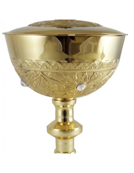 Copón metal dorado con piedras Swarovski Medida: 25 cm de altura x 15 cm de ancho