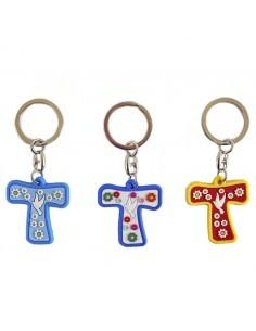 Llavero de plastico con forma de cruz y con espiritu santo  Disponible en distintos colores