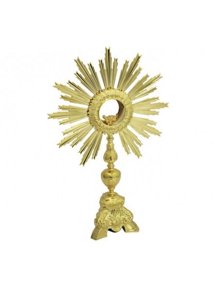 Custodia de metal con acabado dorado y decoración barroca en motivos vegetales. Base de tres pies con volutas.  Dimensiones t