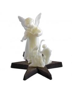 Nacimiento con angel fluorescentes en base de estrella  Medida: 6 cm de alto x 7 cm de ancho