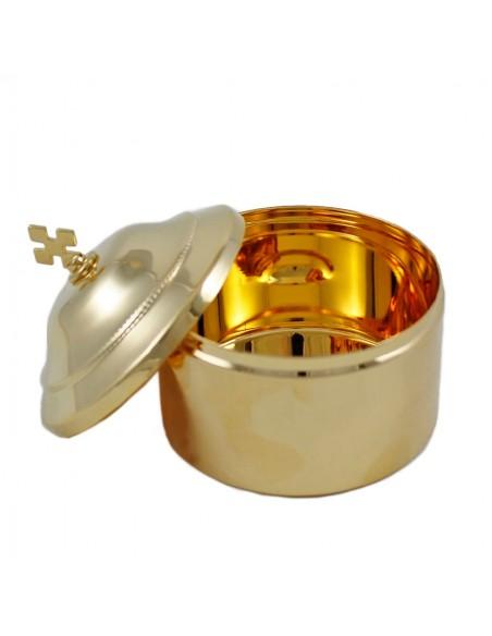 Caja de formas dorada con cruz Ø 9 cm, capacidad para 30 formas.