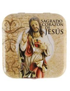 Caja de lata de caramelos de menta. Imagen de Sagrado Corazón de Jesús en la parte exterior de la cajita.