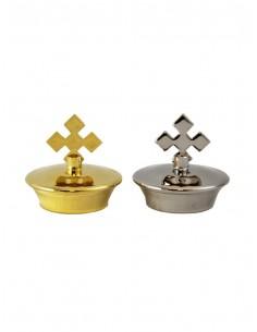 Tapón para jarrita de vinajera con forma de cruz. Disponible en 2 acabados: plateado y dorado.  Diametro 3,5 cm.